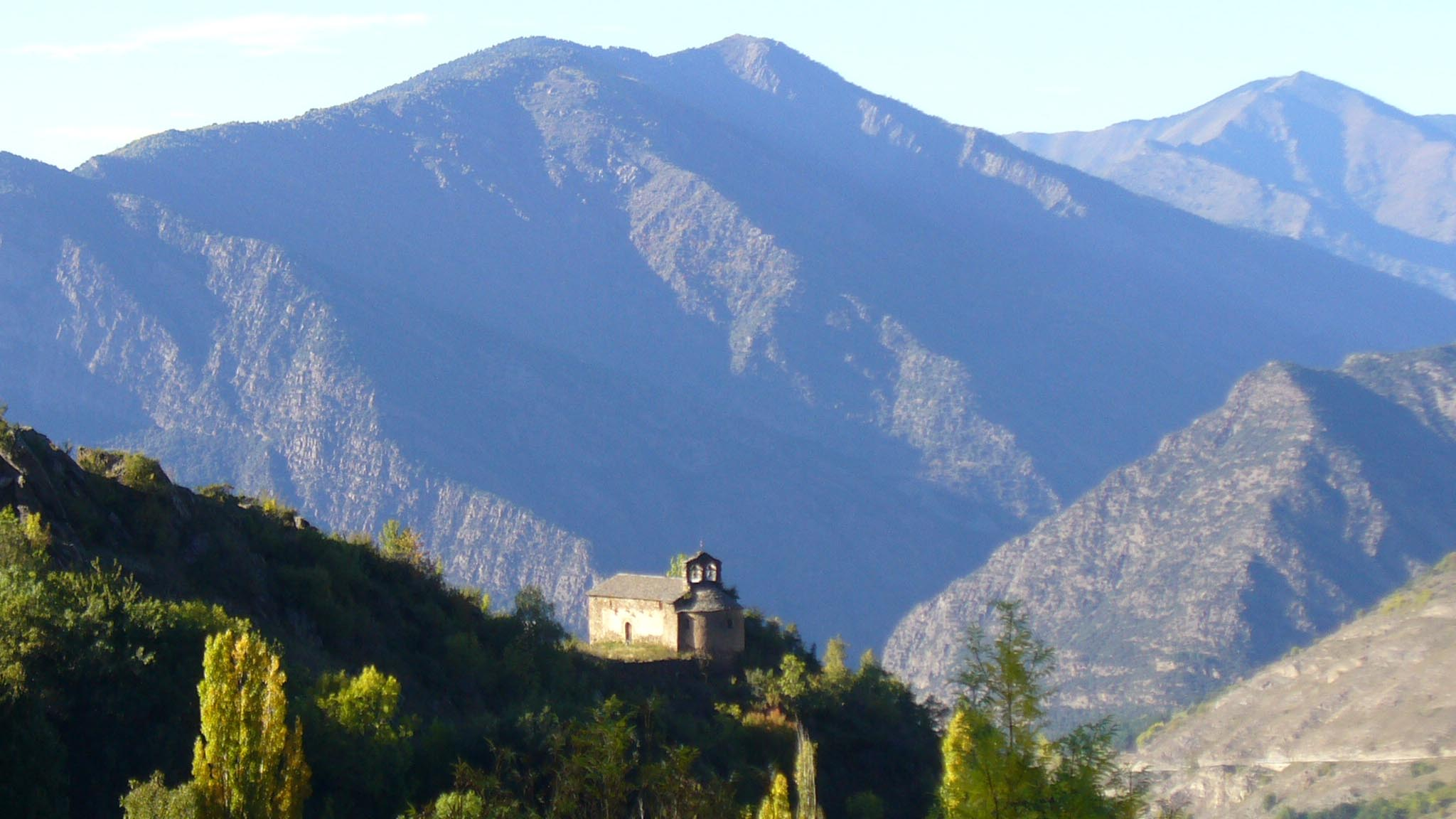 View of the Hermitage of Santa Eulalia d'Alendo from the Centre d'Art i Natura, Farrera, Catalan Pyrenees.